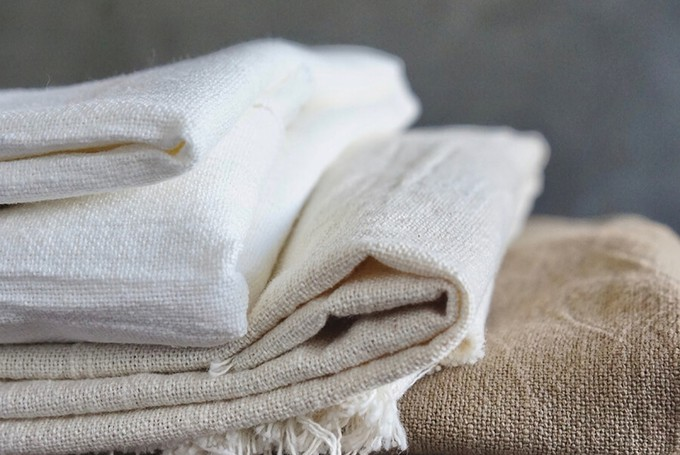 Gently folded linen pieces to show how to care for linen